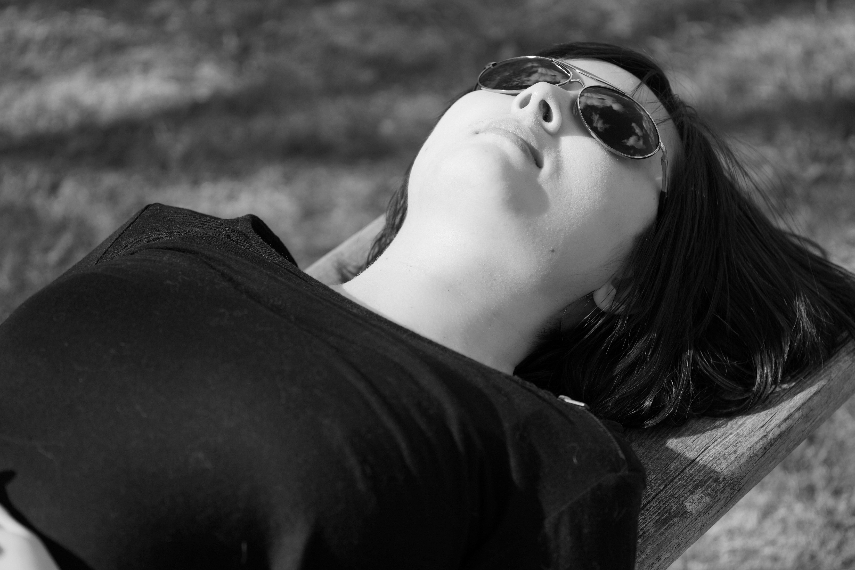 me-lying-on-bench-wearing-sunglasses