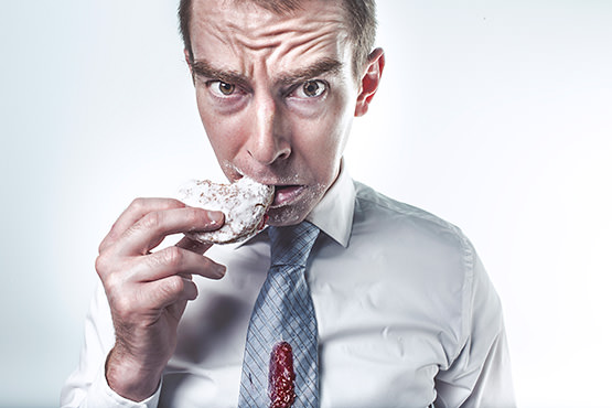 dude-in-tie-eating-donut-messily